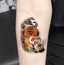Hình xăm nhỏ cute với chú mèo được cách điệu. Hinh Xăm Hổ Chất Mini Tattoo Tribal Facebook