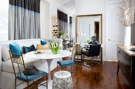 Dazzling Small Seating In Living Space With Round White Coffee Table Also  White Sectional Sofa On Brown Wooden Floor