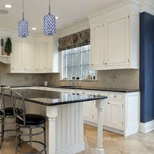 how many mini pendants or chandeliers are needed over the kitchen island