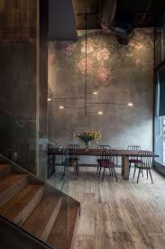 lighting high ceilings. the high ceilings in concrete softened with a delicate pretty mural unpolished wood flooring and lighting