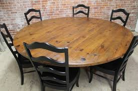 brick wall design with large 60 inch round table set using black ladder back chairs