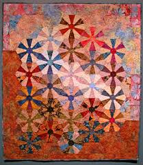 Quilting With Heart - The Cedar Hill Report - An Ecofeminism Blog ... & Gold Dust, 2001, inspired by the traditional Wagon Wheel block featuring  contemporary batiks and even a lame fabric. Adamdwight.com