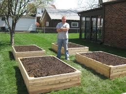 setting up a vegetable garden elegant bp builds four raised garden beds for setting up