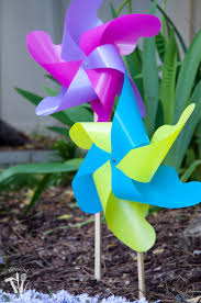 how fun are these pinwheels these diy giant outdoor pinwheels are made from plastic so