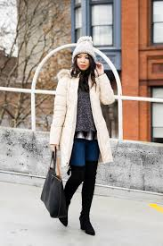 ten cute puffer jackets with faux fur hood winter outfit over the knee boots