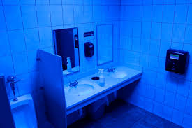 a public bathroom bathed in blue light is seen at this turkey hill convenience in