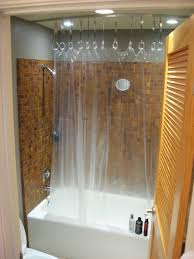 here s the overall idea for a ceiling mounted shower curtain the link for the actual track is also saved on this board i would add long curtains over