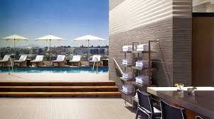 hotel pool area and exterior walls feature porcel thin wood effect large porcelain tiles