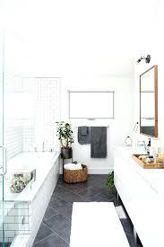 white bathrooms with grey floors dark floor tile white subway tile on walls white everything else
