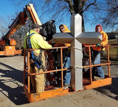 jim dorge brian holt and cole bocklage prepare to lift the refurbished stainless