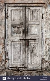 old wooden door with old rusty locks stock image