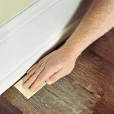 if you are going to refinish make sure you use a very fine grain sand paper and sanding must be done by hand as you could go through the wood layer and
