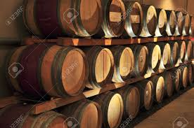oak wine barrels. stacked oak wine barrels in winery cellar stock photo 4616881 o