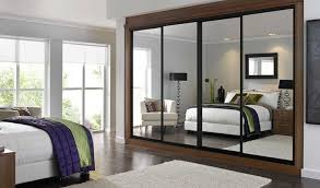 image mirrored sliding. White Interior Color With Modern Wardrobe Design Using Mirrored Sliding Doors For Comfortable Bedroom Ideas Image