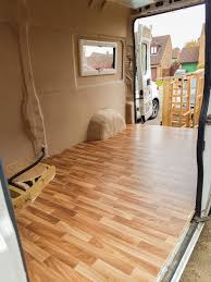 van conversion installing lino flooring in a campervan