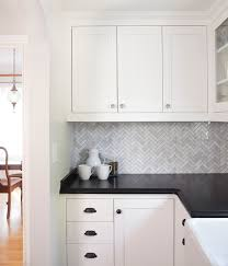 view full size stunning kitchen with white cabinets painted benjamin moore simply white paired with honed absolute black granite countertops