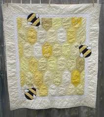 This adorably cheerful baby quilt is sure to bring a smile to ... & This adorably cheerful baby quilt is sure to bring a smile to everyones  face with its honeycomb pattern, sunshiny colors, and handstitched blackwor… Adamdwight.com