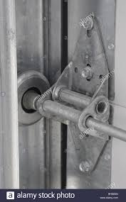 Track roller and hinge on commercial roll up garage door Stock ...