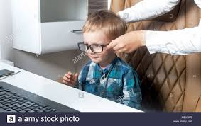 Image White Portrait Of Cute Toddler Boy Sitting In Office Chair And Wearing Eyeglasses Alamy Portrait Of Cute Toddler Boy Sitting In Office Chair And Wearing