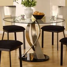 expandable round dining table black glass top brown laminated wooden dining chair brown laminated wooden floor