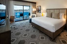 king bed with marina view