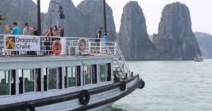 halong day tour islands caves kayak with dragonfly cruise hanoi vietnam getyourguide