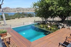 miniature natural pool with aqua green ceramic tiles