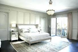 rug under king bed carpet under bed lake residence transitional bedroom carpet bedroom floor what size rug under king