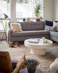 eclectic living room with contemporary white coffee table