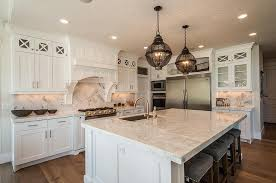 Lovely White Kitchen Island With Black Cage Lanterns