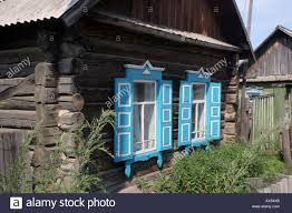 Cabin Windows a log cabin of rough wood and blue shutters on the windows with 4244 by uwakikaiketsu.us