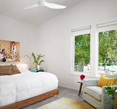 white ceiling fan in bedroom. amazing white ski shores lakehouse stuart sampley architect bedroom interior with wooden bed and colorful pillows ceiling fan in i