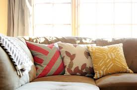 gray and pink cross striped pillow featuring leaf patterned throw pillow and yellow patterned sofa pillow