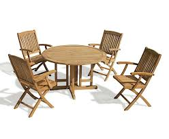 berrington round eg 1 2m table 4 bali armchairs