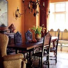 tuscan style dining room washed wall color and wrought iron chandelier and wooden table and chairs