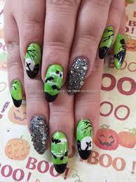 Eye Candy Nails & Training - Green and black halloween nail art ...