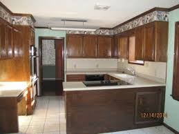 kitchen cabinet refacing using wall paper hometalk