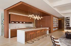 large open kitchen space focused on modern wooden key element principle of interior with decorative glass pendant lamps
