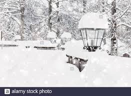 Snowfall Blizzard Lights Streetlight Lamps With Fresh Snowfall In Winter On Street