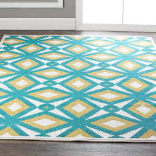 teal and yellow rug