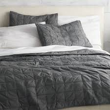 modern quilt squares up textural blocks in cool grey handstitched with contrasting