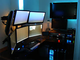 2 computers 7 monitors and a custom desk to hide cables