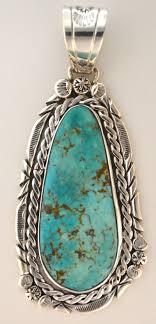 a stunning pendant captures the natural design in the turquoise stone