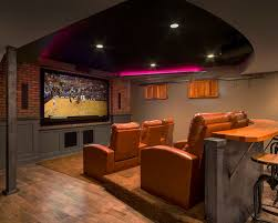 home theater floor lighting. elegant medium tone wood floor and brown home theater photo in kansas city with lighting e