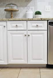 white painted kitchen cabinetsHow to paint your kitchen cabinets for a smooth painted finish