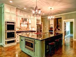impressive large custom built kitchen islands with polished black granite also circular wrought iron chandelier
