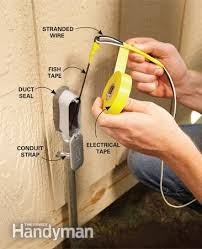 electrical wiring how to run power anywhere the family handyman photo 7 tie the wire to the fish tape