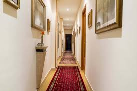 hallway track lighting. Hallway Decorated With Framed Wall Pictures And Runners Also Using Recessed Lighting Track P