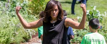 White House Kitchen Garden First Lady Michelle Obama Flexes Muscles While Harvesting White