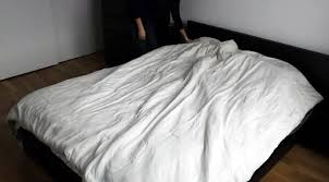 the duvet burrito how to put a duvet cover on your comforter the easy way housekeeping wonderhowto